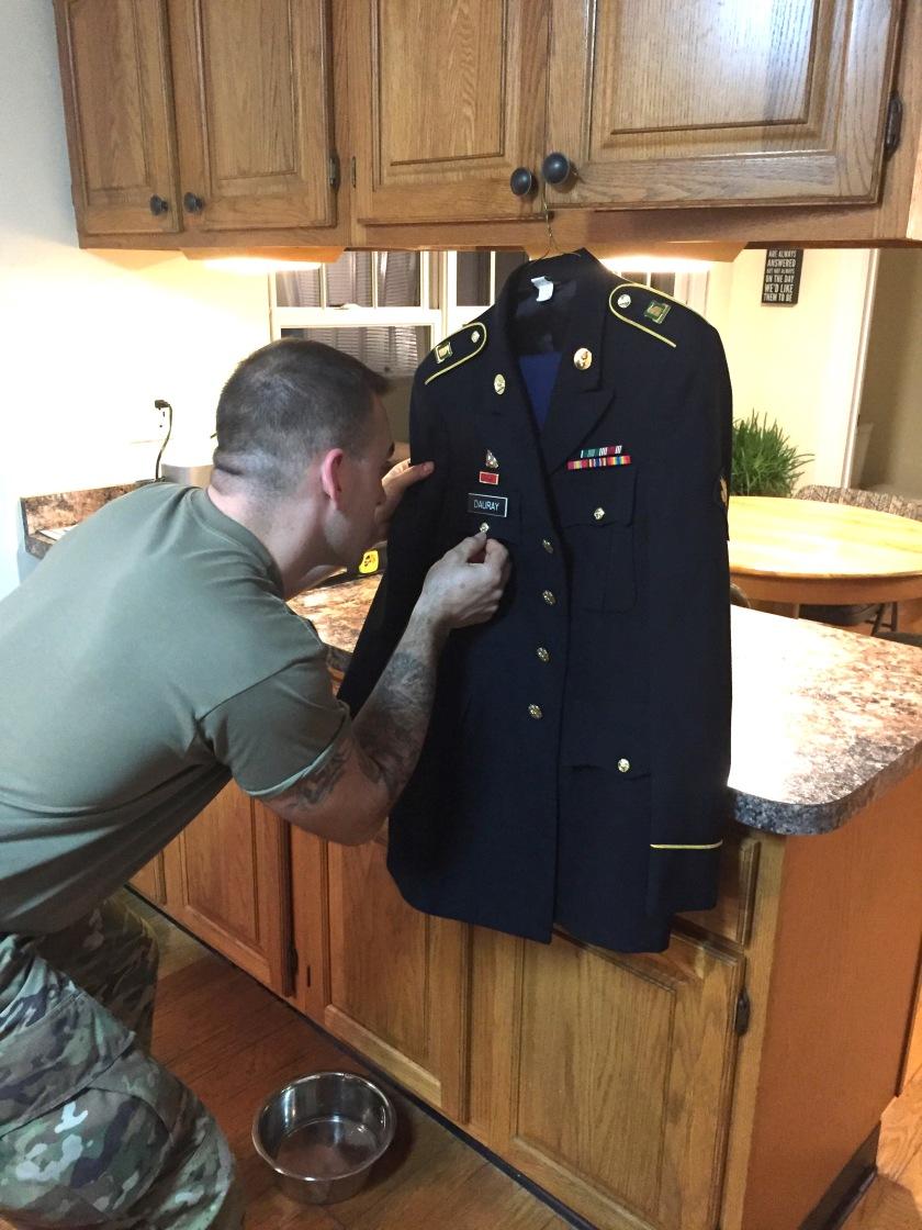 David working on his uniform